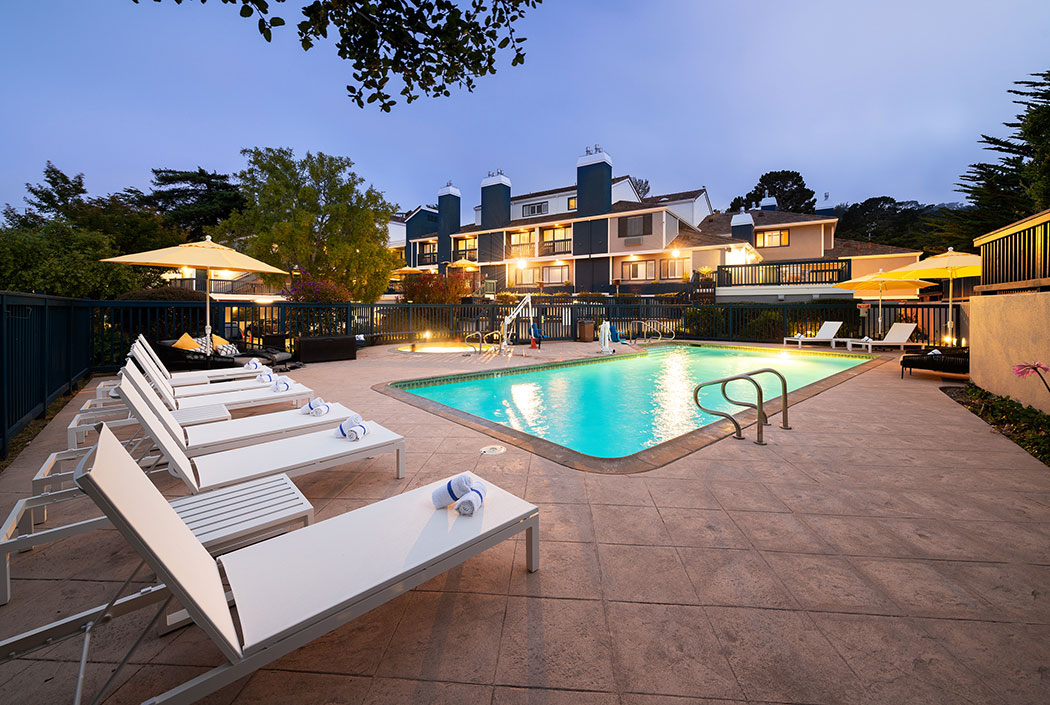LOUNGE BESIDE OUR SPARKLING OUTDOOR POOL